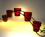 bridge votive holder, wrought iron bridge votive holders, bridge cup holder, ruby red votive cups with bridge holders